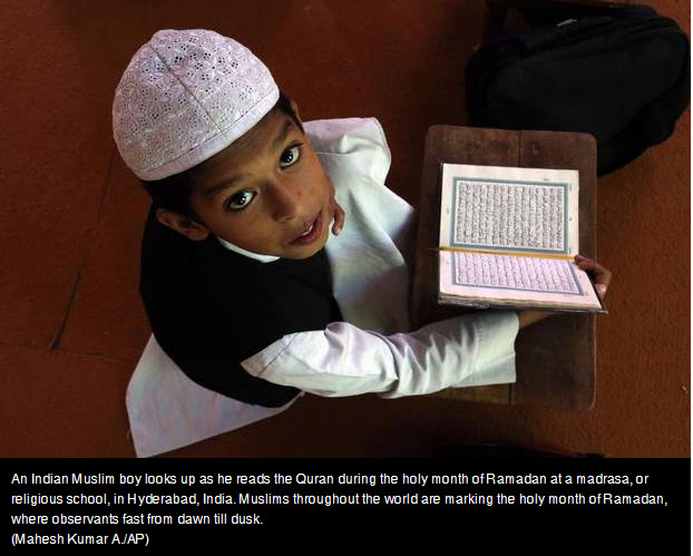 Child reading Koran